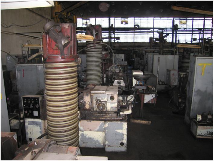 Automatic lines for grinding and superfinishing tapered rollers
